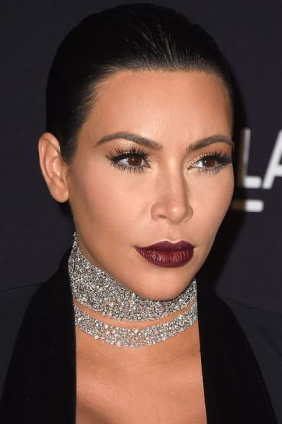 hbz-the-list-holiday-hair-makeup-kim-kardashian-gettyimages-496338844